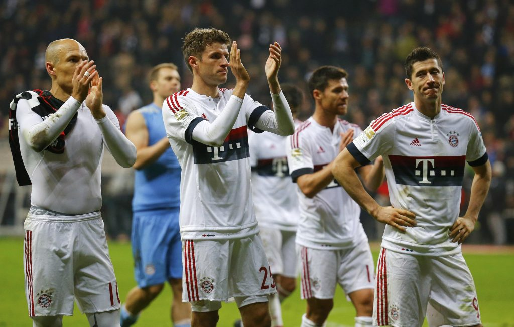 Bayern Munich's Arjen Robben, Thomas Mueller and Robert Lewandowski (L-R) react after their German first division Bundesliga soccer match in Frankfurt, Germany, October 30, 2015. REUTERS/Kai Pfaffenbach DFL RULES TO LIMIT THE ONLINE USAGE DURING MATCH TIME TO 15 PICTURES PER GAME. IMAGE SEQUENCES TO SIMULATE VIDEO IS NOT ALLOWED AT ANY TIME. FOR FURTHER QUERIES PLEASE CONTACT DFL DIRECTLY AT + 49 69 650050