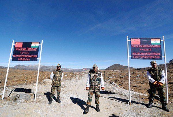 Indian Army personnel keep vigilance at Bumla pass at the India-China border in Arunachal Pradesh on October 21, 2012. Bumla is the last Indian Army post at the India-China border at an altitude of 15,700 feet above sea level. AFP PHOTO/ BIJU BOROBIJU BORO/AFP/Getty Images ORG XMIT: ** TCN OUT **
