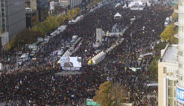 SEOUL, SOUTH KOREA - NOVEMBER 12: South Korean people march during a demonstration, demanding the resignation of South Korean President, Park Geun-hye at Gwanghwamun square in Seoul, South Korea on November 12, 2016. (Photo by Kim Jong-Hyun /Anadolu Agency/Getty Images)