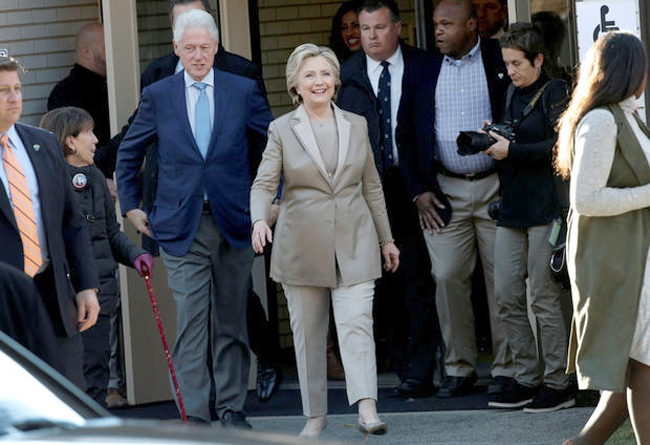 Democratic U.S. presidential nominee Hillary Clinton and her husband former U.S. president Bill Clinton depart after voting in the U.S. presidential election at the Grafflin Elementary School in Chappaqua, New York, U.S., November 8, 2016. REUTERS/Mike Segar